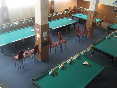 Billiard sport game balls on blue table on billiard club ready to play, stock photo